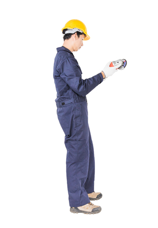 Young handyman in uniform hold grinder, Cutout isolated on white background