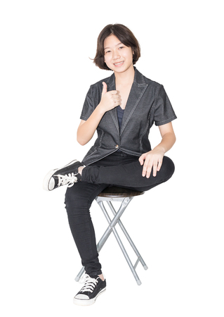 Asian women sit on chair ,Cut out isolated over white background photo