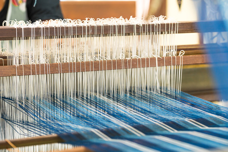 Weave silk cotton on the manual wood loom in Thailand ,The process of silk weaving in the production of Thai silk