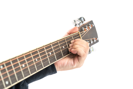 Woman musician hands playing guitar isolated on white