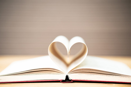 Pages of book curved into a heart shape ,Love concept of heart shape from book pages