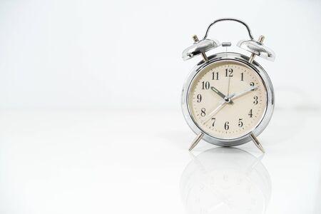 Silver alarm clock isolated on white background Stockfoto - 128809754