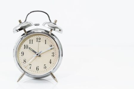 Silver alarm clock isolated on white background Stock Photo