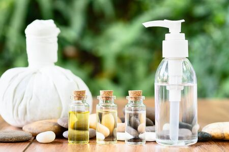 Thai Spa massage setting with bottle with essential oil and thai herbal compress balls