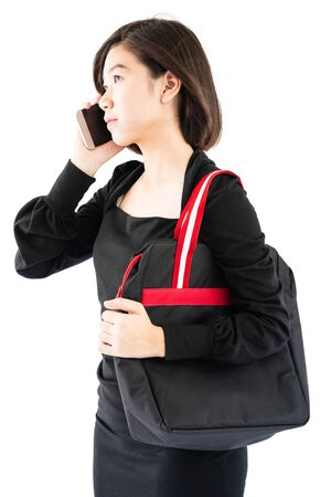 Woman carrying a black shopping bag using cellphone shopping online isolate on white background