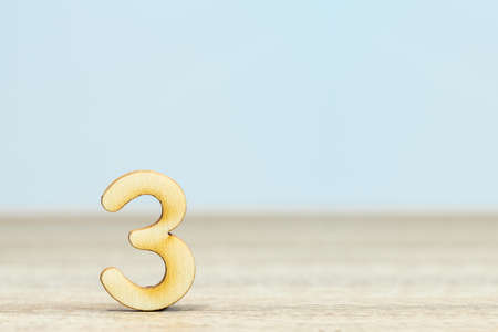 Close up wooden numeric on table with copy space,number seven Stockfoto