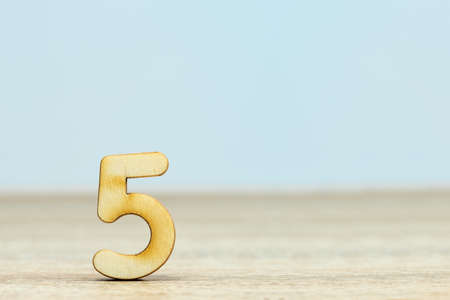 Wooden numeric 4 with drop shadow on white background