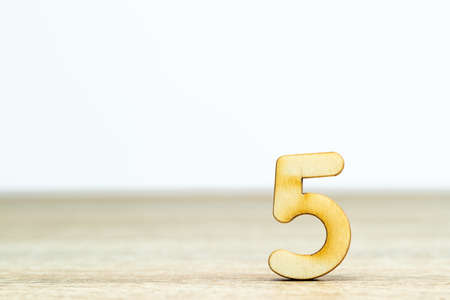 Close up wooden numeric on table with copy space,number six