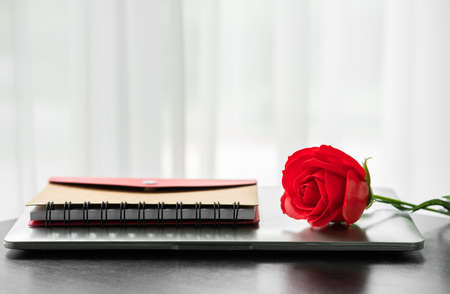 Red rose on the wood table agent white background ,Valentine concept