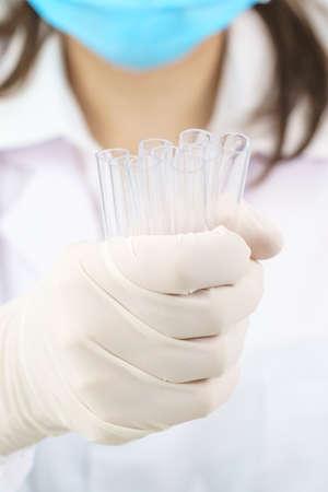 Technician scientist analyzing a blood sample in test tube in laboratory for testing it on COVID, COVID-19, coronavirus virus analysis Standard-Bild
