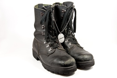 army boots: Picture of some old army boots with a dog-tag hanging