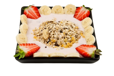healthy musli breakfast with strawberries and bananas photo
