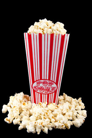 Picture of some popcorn in a holder with popcorn on the bottom