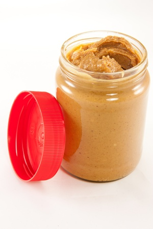 Picture of a jar of delicious peanut butter with a lid photo