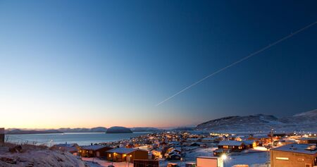 Picture of a part of the  northermost city in the world, Hammerfest  The sun is just in the horizon during day time Stock Photo