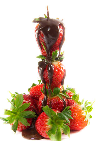 A picture of melted chocolate that is poured over a tower of strawberries Stock Photo - 12744605