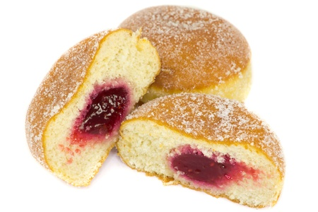dough nut: A picture of two jelly donuts where one is cutted in half, showing jelly Stock Photo