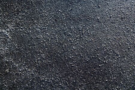 Picture of a piece of asphalt littered with salt photo