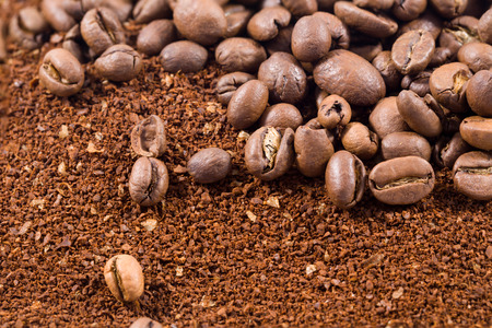 Picture of a group of coffee beans with coffee powder