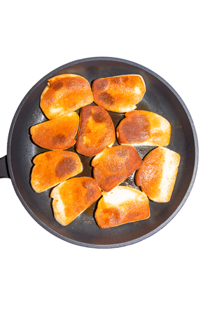 Picture of norwegian fish pudding slices in a frying pan Stock Photo