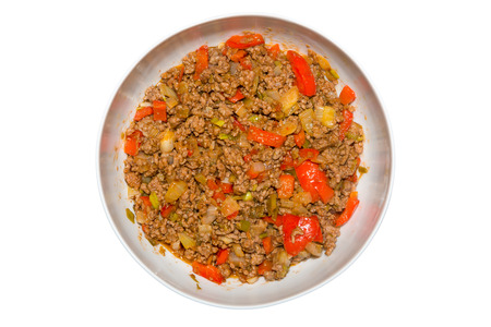 Picture of a mixed dish with minced meat, paprika, spring onions, and onions Stock Photo