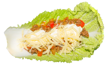 Picture of a salad leaf with a meat mixture with sour cream and cheese Stock Photo