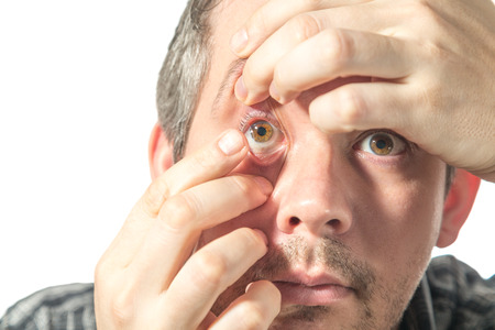 wearer: Picture of a man putting on a contact lens