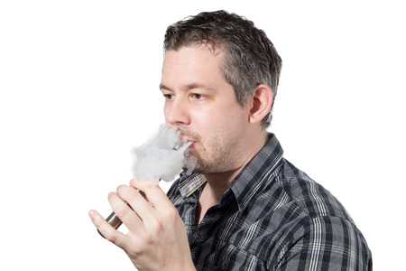 Picture of a man smoking on a e cigarette with smoke beeing exhaled