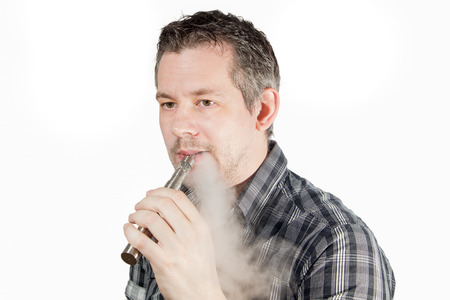 e cigarette: Picture of a man smoking on a e cigarette with smoke beeing exhaled