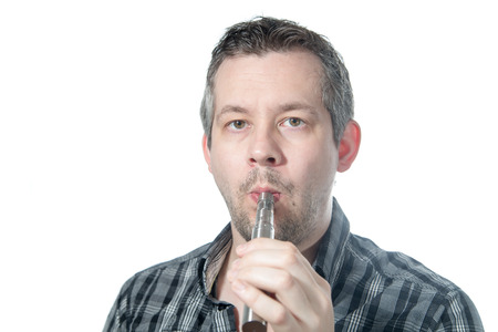 Picture of a man smoking a e cigarette Stock Photo