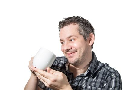Picture of a man that cares really much about his coffee Stock Photo
