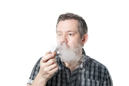 Picture of a man that is smoking on a pipe, while exhaling smoke