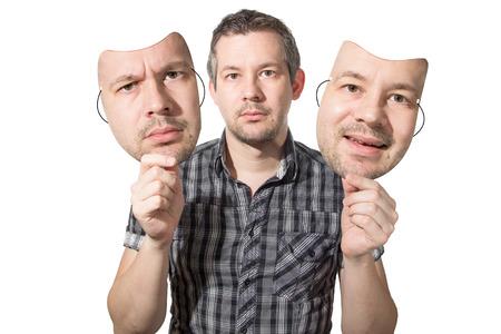 Foto van een man het kiezen van de juiste gezicht voor de dag Stockfoto