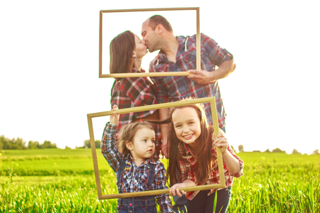 family photo: family in the field with a frames Stock Photo