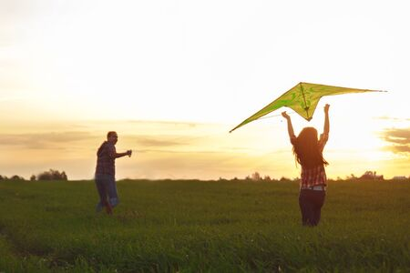 A man with a girl launches a kite