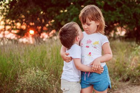 kiss love: little girl and boy hugging