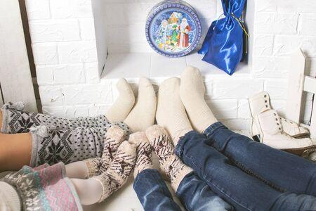 cosily: family near the Christmas fireplace