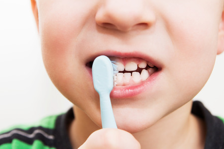 childs teeth with a toothbrush