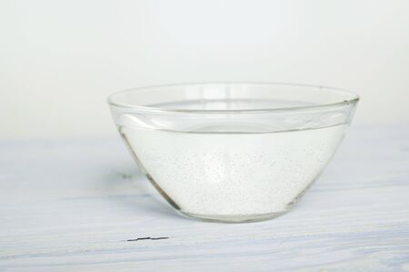 water in a bowl on a white background