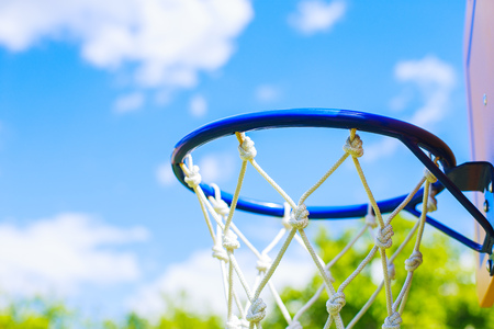 net: Basketball ring on blue sky background