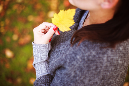 portrait of a girl with an autumn leaf in her hand Stock Photo