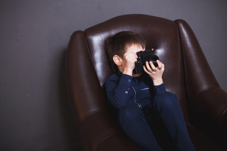 boy  with a camera. boy takes pictures