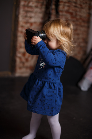 girl  with a camera. Little girl takes pictures
