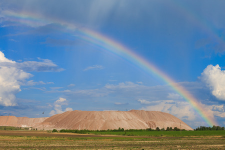 Soligorsk mountains. potash plant. Potash mountains near Soligorsk City. rainbow in the sky