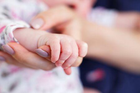 little hand of a newborn baby close
