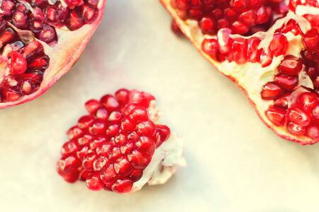 pomegranate seeds close-up.  pomegranate on a light background Stock Photo