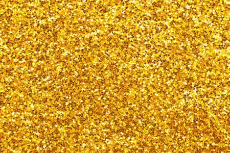 glittering background of a golden sequins closeup. Sparkle festive texture Reklamní fotografie