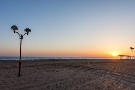 on the beach there is a lantern for lighting in the dark Stock Photo