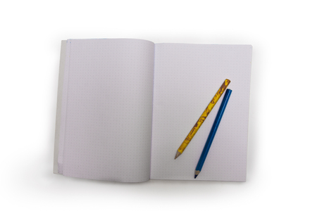 pencils of different colors on the notebook Standard-Bild