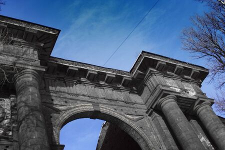 dreadful: Twilight old gate with the dark sky